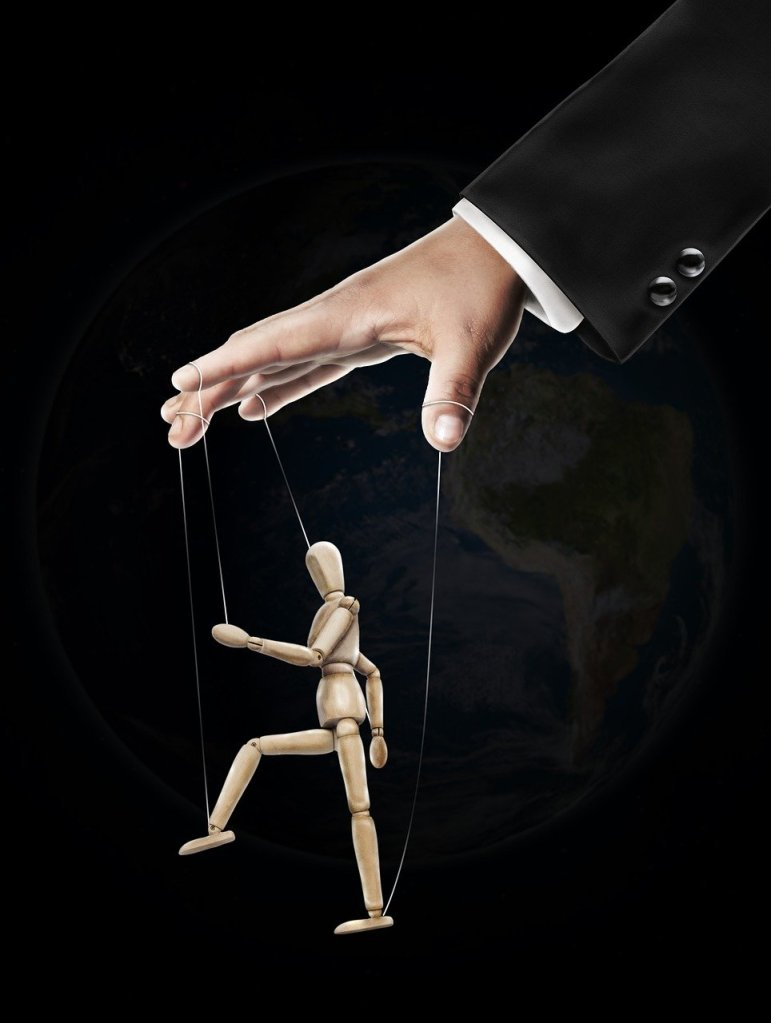 A puppet on strings being controlled by a master.